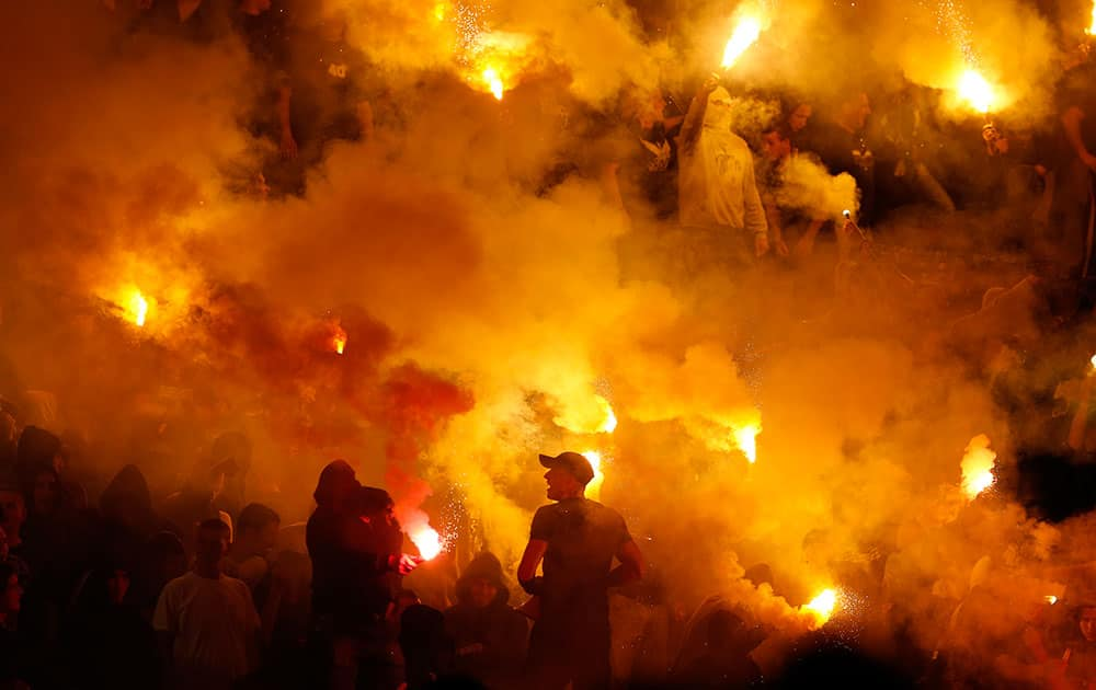 Partizan soccer fans light torches during a Serbian National soccer league derby match between Red Star and Partizan, in Belgrade, Serbia.