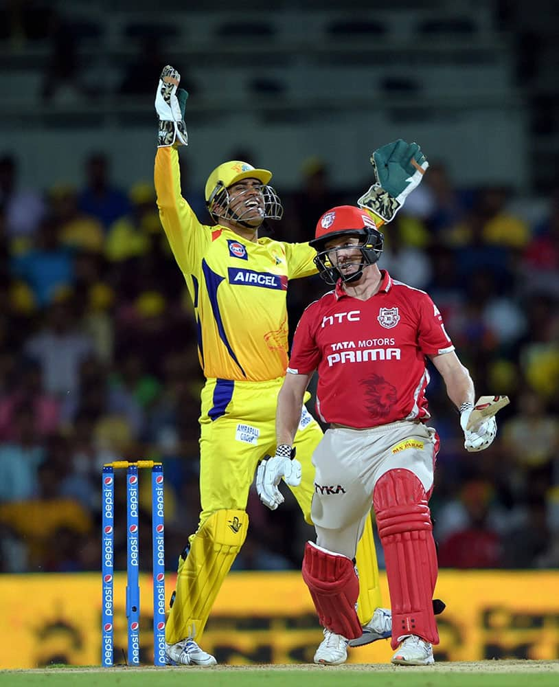 CHENNAI SUPER KINGS' SKIPPER MS DHONI CELEBRATING FOR THE WICKET OF KINGS XI PUNJAB SKIPPER GEORGE BAILEY DURING THE IPL-2015 MATCH AT MAC STADIUM IN CHENNAI.