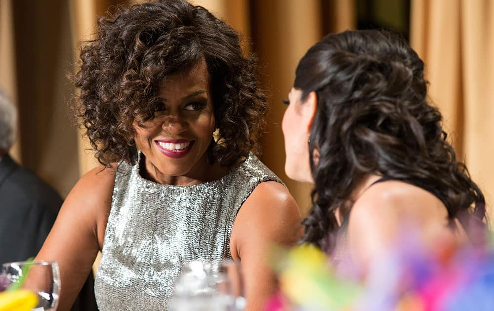 First lady Michelle Obama mingles during the White House Correspondents' Association dinner at the Washington Hilton, in Washington.