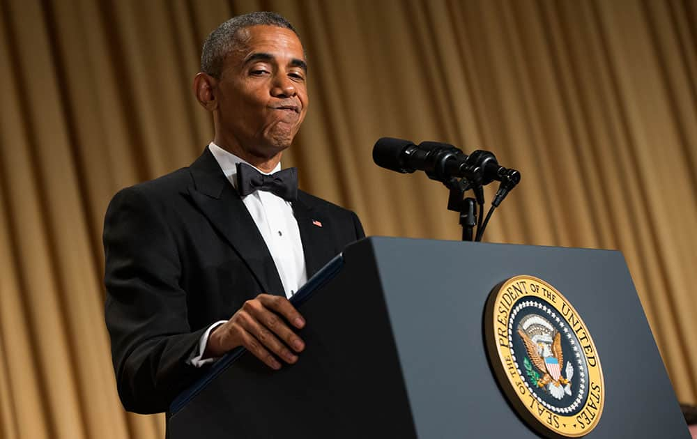 President Barack Obama gestures as he delivers remarks during the White House Correspondents' Association dinner at the Washington Hilton, in Washington.