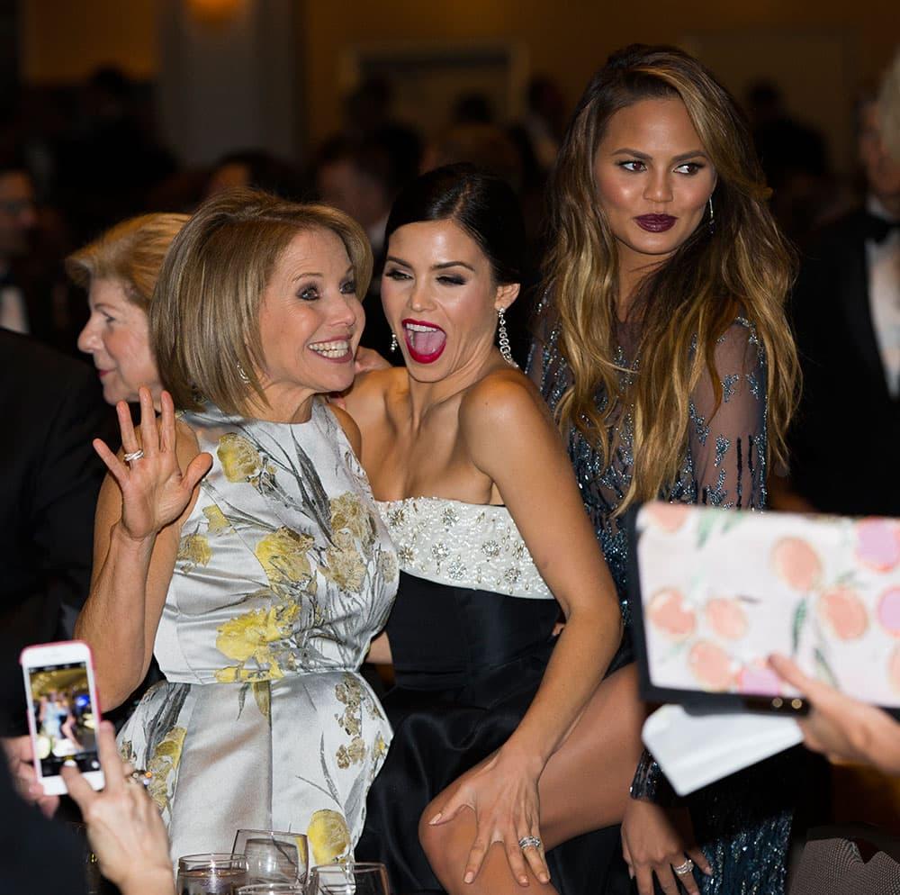 News personality Katie Couric, left, Jenna Dewan-Tatum, center, and model Chrissy Teigen mingle during the White House Correspondents' Association dinner at the Washington Hilton, in Washington.