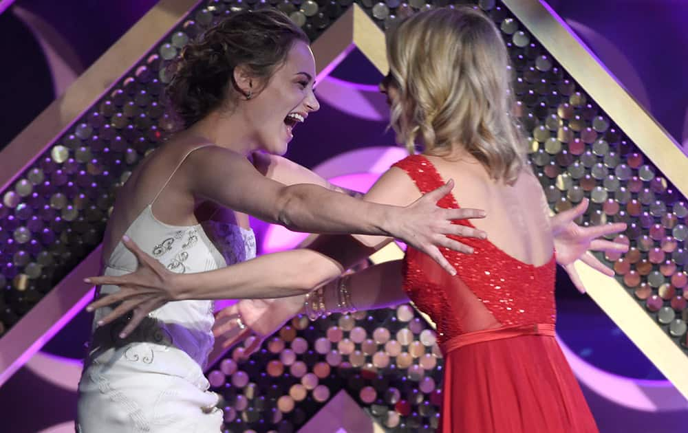 Linsey Godfrey, right, presents Hunter King with the award for outstanding younger actress in a drama series at the 42nd annual Daytime Emmy Awards at Warner Bros. Studios.