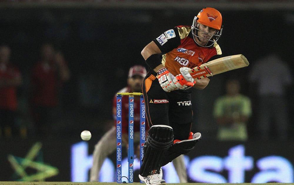 Sunrisers Hyderabads David Warner plays a shot during an IPL match against Kings XI Punjab in Mohali.