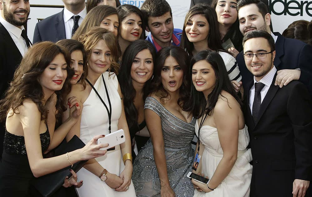 Mexican and American actress Salma Hayek poses for photographers with fans as she arrives to her international premiere film The Prophet, an animated feature film she co-produced, in Beirut, Lebanon.