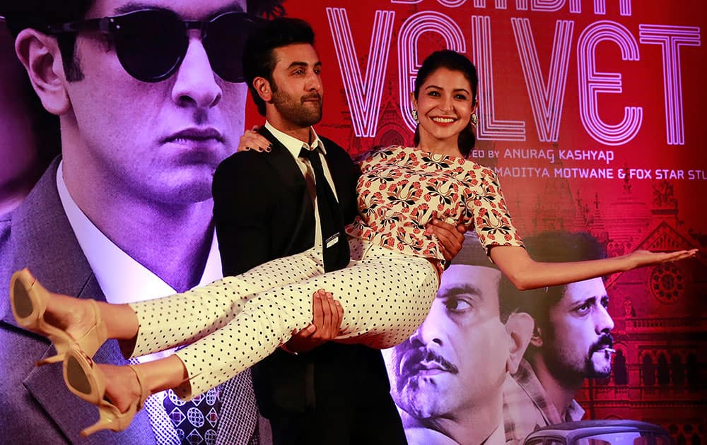 Bollywood actor Ranbir Kapoor poses for photographs with actress Anushka Sharma during a trailer launch of their film Bombay Velvet in Mumbai.