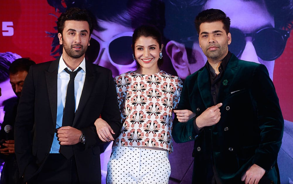 Bollywood actors Ranbir Kapoor, Anushka Sharma and Karan Johar pose during a trailer launch of their film Bombay Velvet in Mumbai.