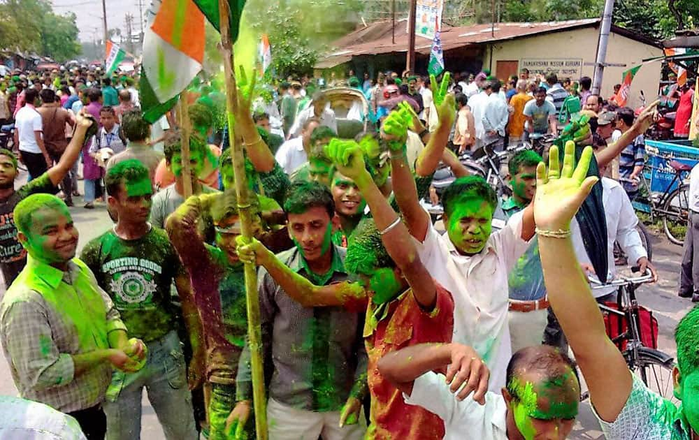 Trinamool Congress supporters celebrate after winning in the Municipal Election.