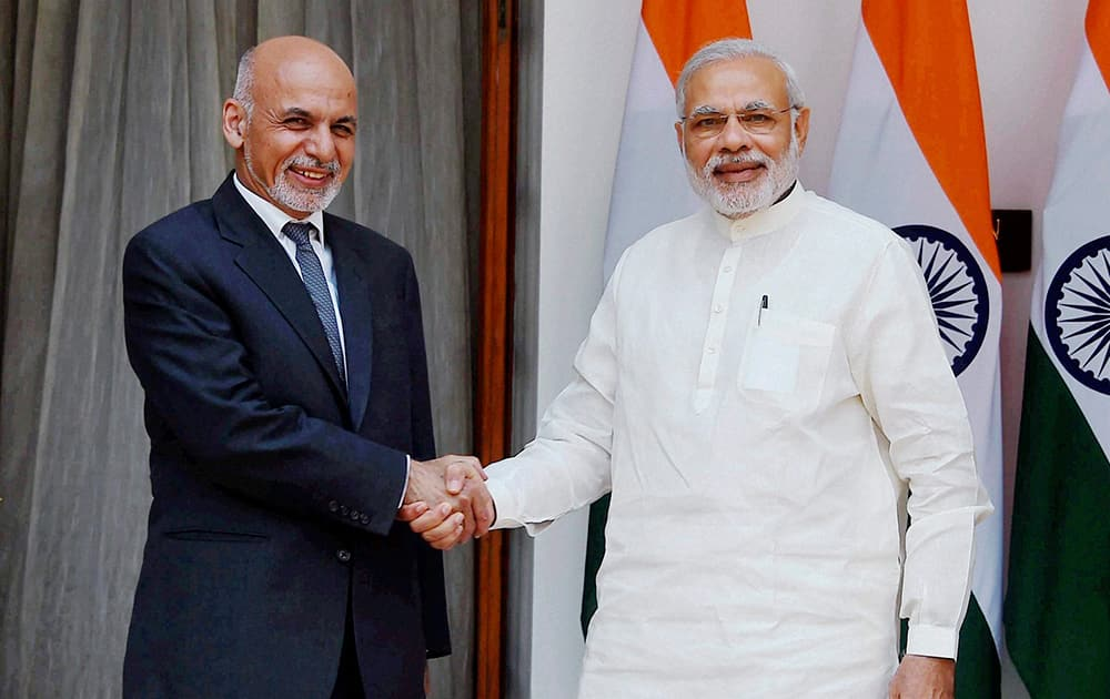 PM Narendra Modi shakes hands with Afghan President Mohammad Ashraf Ghani during a meeting at Hyderabad House in New Delhi.