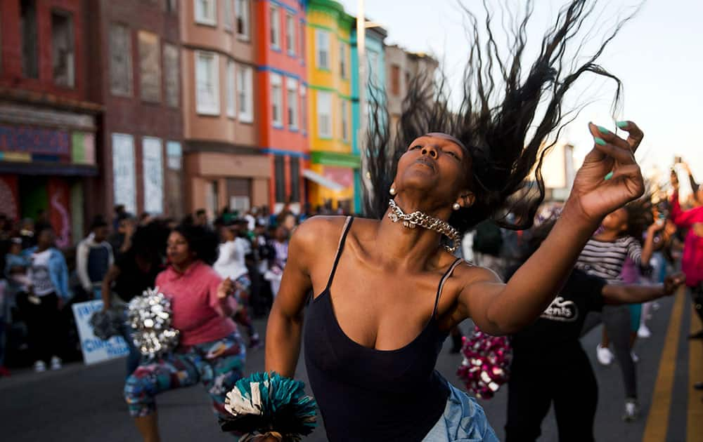 People dance in Baltimore. Maryland's governor vowed there would be no repeat of the looting, arson and vandalism that erupted Monday in some of the city's poorest neighborhoods.