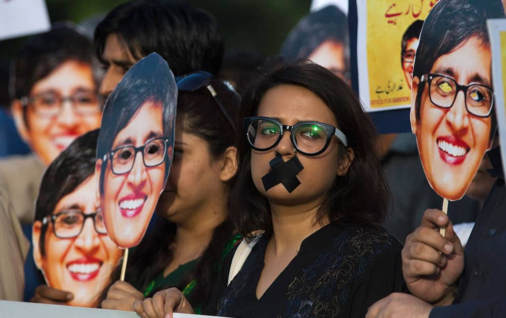 Supporters of prominent womens rights activist Sabeen Mahmud, who was killed by unknown gunmen, hold her pictures during a rally, in Islamabad, Pakistan.