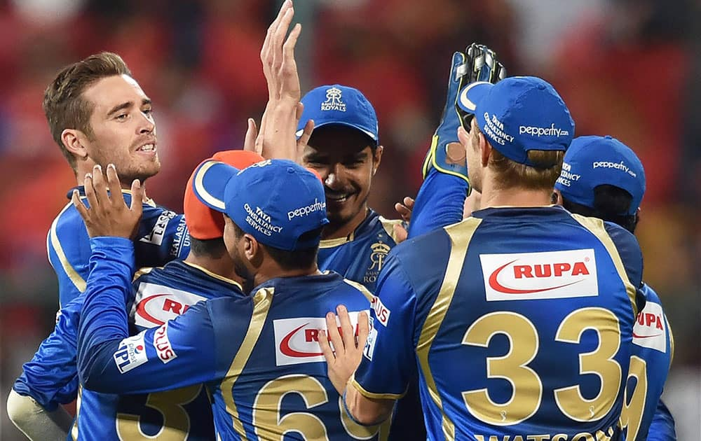 Rajasthan Royals Tim Southee celebrates with team mates the wicket of Chris Gayle during IPL 8 match against Royal Challengers Bangalore in Bengaluru.