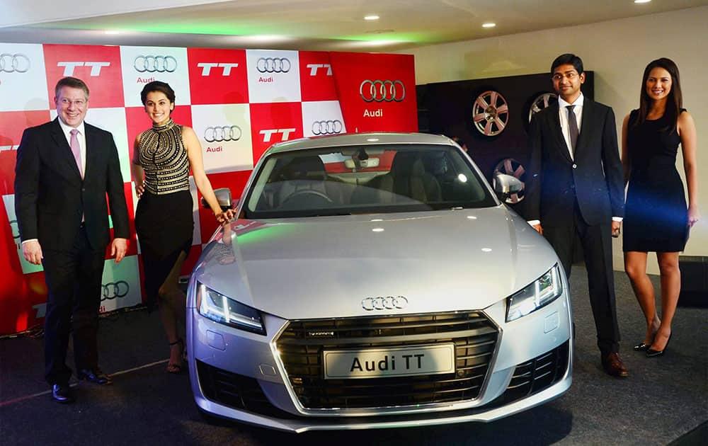 Actor Taapsee Pannu and Joe King, head, Audi India, during the inauguration of an Audi showroom in Madurai.