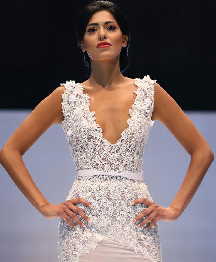 A model displays a creation by Lebanese international designer Abed Mahfouz during his Spring-Summer 2015 fashion show, in Beirut, Lebanon.