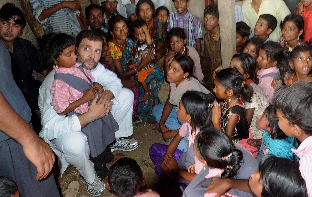 Congress Vice President Rahul Gandhi meeting with children during his 'Padyatra' in Tonglabad village in Amravati district of Maharashtra.
