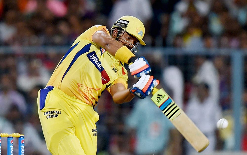 CSK batsman Suresh Raina plays a shot during IPL Match against KKR at Eden Garden in Kolkata.