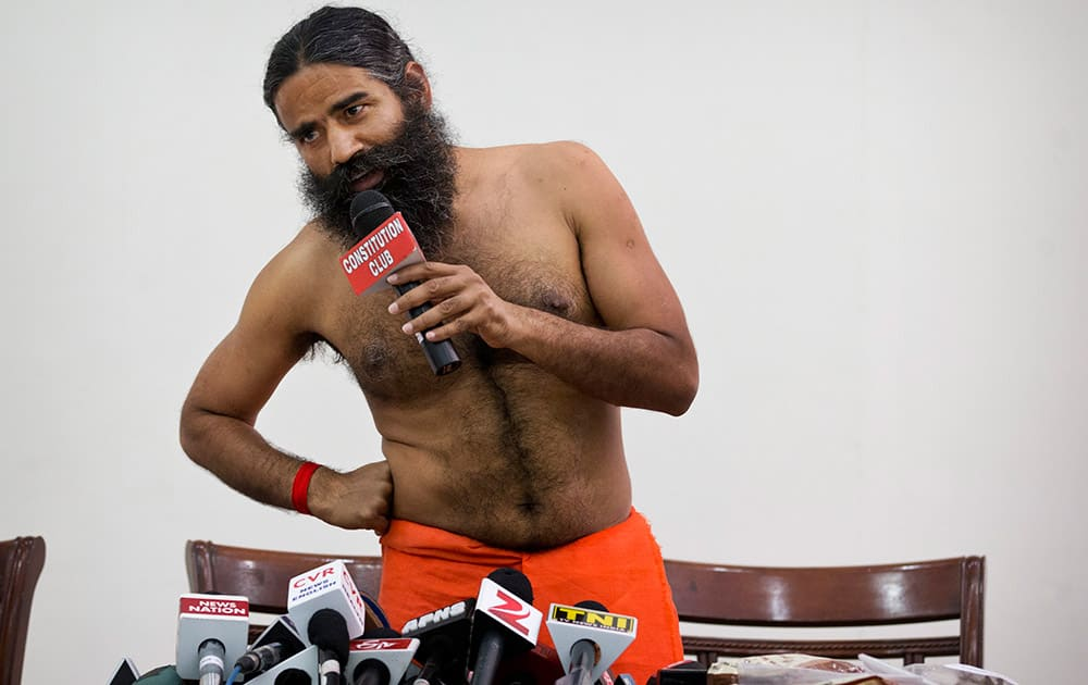 """Baba Ramdev speaks to the media about an Ayurvedic medicine called """"Putrajeevak Beej"""", which is produced by Patanjali Ayurveda Kendra, part of a trust established by him in New Delhi."""