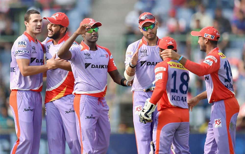 Delhi Daredevils bowler N Coulter-Nile celebrates with his teammates after he takes wicket of Kings XI Punjab batsman WP Saha during an IPL match, New Delhi.