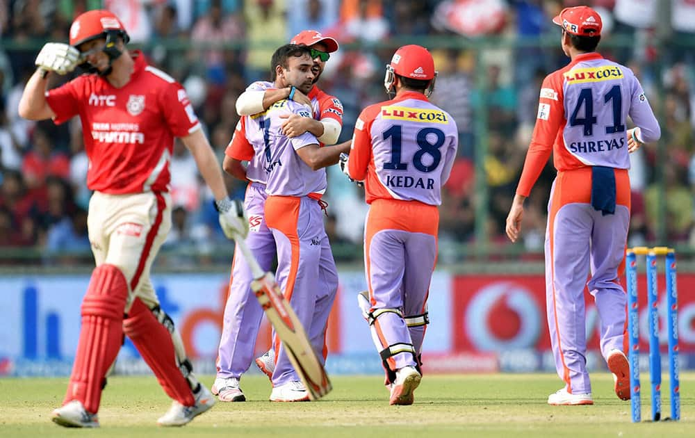 Delhi Daredevils bowler Amit Mishra celebrate with team mates after taking wicket of Kings XI Punjabs captain George Bailey (L) during an IPL match in New Delhi.