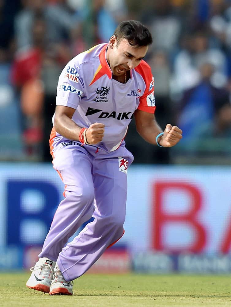Delhi Daredevils bowler Amit Mishra celebrates after taking wicket of Kings XI Punjabs captain George Bailey during their IPL match in New Delhi.