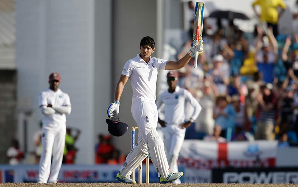 England captain Alistair Cook celebrates scoring a century against West Indies during day one of their third Test match at the Kensington Oval in Bridgetown, Barbados.