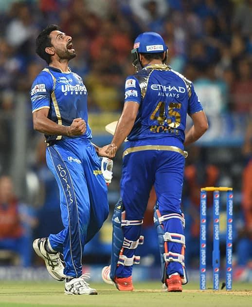 Rajasthan Royals bowler Dhawal Kulkarni celebrates the wicket of Mumbai Indians batsman Rohit Sharma during an IPL match in Mumbai.