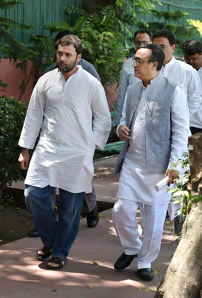 AICC Vice President Rahul Gandhi with Delhi Congress chief Ajay Maken arrives to meet representatives of organizations of home/flat buyers in Delhi-NCR region, at AICC office in New Delhi.