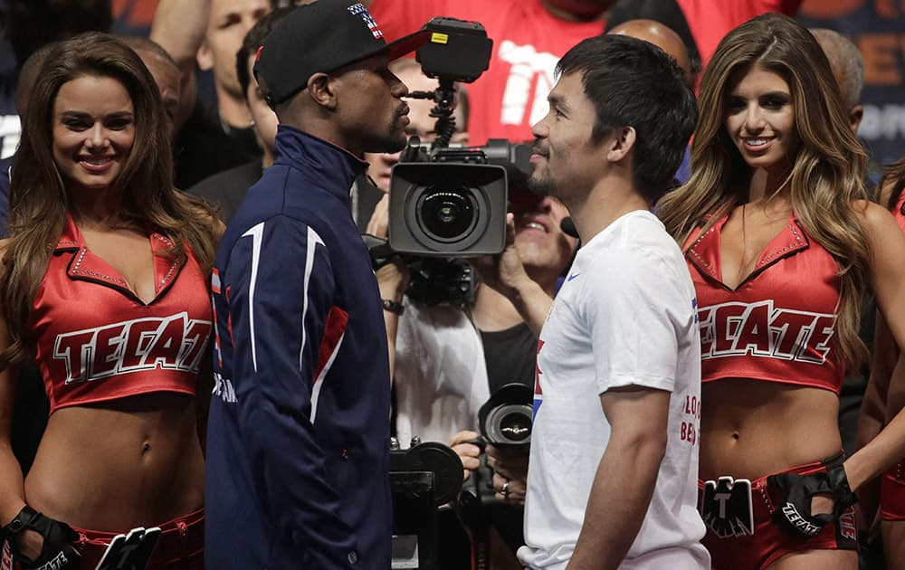 Floyd Mayweather Jr. and Manny Pacquiao pose during their weigh-in. The world weltherweight title fight between Mayweather Jr. and Pacquiao is scheduled for May 2.