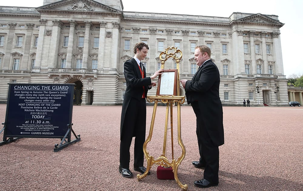 An easel is placed in the forecourt of Buckingham Palace in London to announce the birth of the royal baby. Kate, the Duchess of Cambridge, has given birth to a baby girl, royal officials said Saturday.