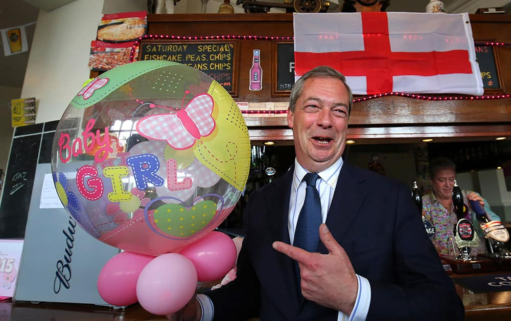 Britain's United Kingdom Independence Party (UKIP) leader Nigel Farage celebrates the birth of the Royal baby at a public house in Ramsgate, Kent, during a day of campaigning for the the upcoming general election.