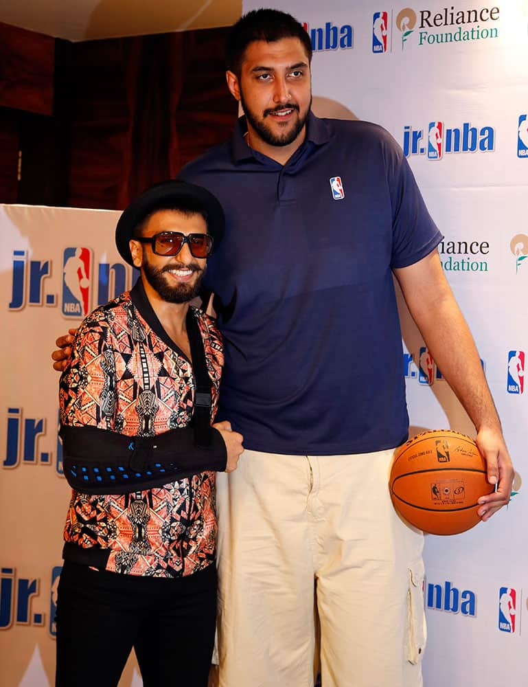 NBA's first player of Indian descent Sim Bhullar poses for photographers with Bollywood actor Ranveer Singh during a press conference in Mumbai, India.