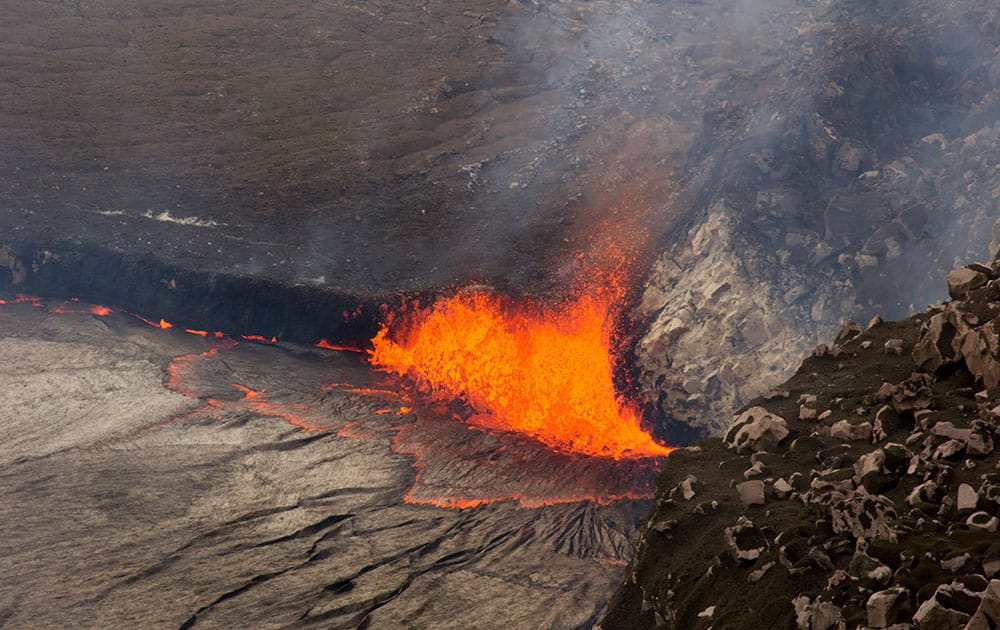 this  photo provided by US Geological Survey Hawaiian Volcano Observatory, sparks rise from Kilauea volcano on Hawaii's Big Island.