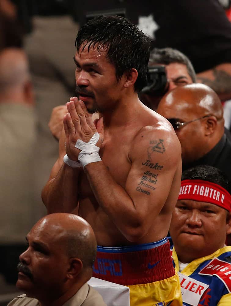 Manny Pacquiao, from the Philippines, greets fans after his welterweight title against Floyd Mayweather Jr., in Las Vegas.