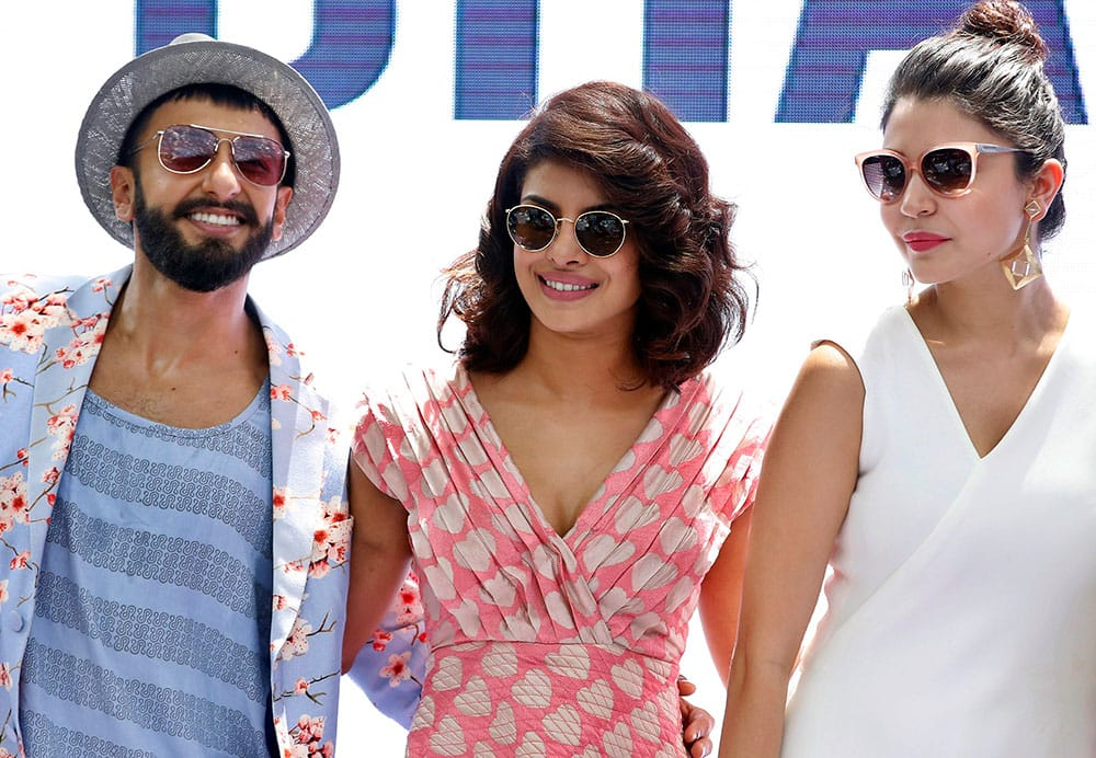 Bollywood actors from left, Ranveer Singh, Priyanka Chopra and Anushka Sharma pose during the song launch of their upcoming movie 'Dil Dhadakne Do' in Mumbai.