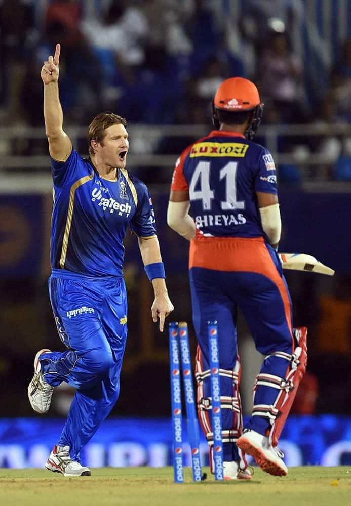 Rajasthan Royals player Shane Watson celebrates the wicket of DDs Shreyas Iyer during an IPL match in Mumbai.