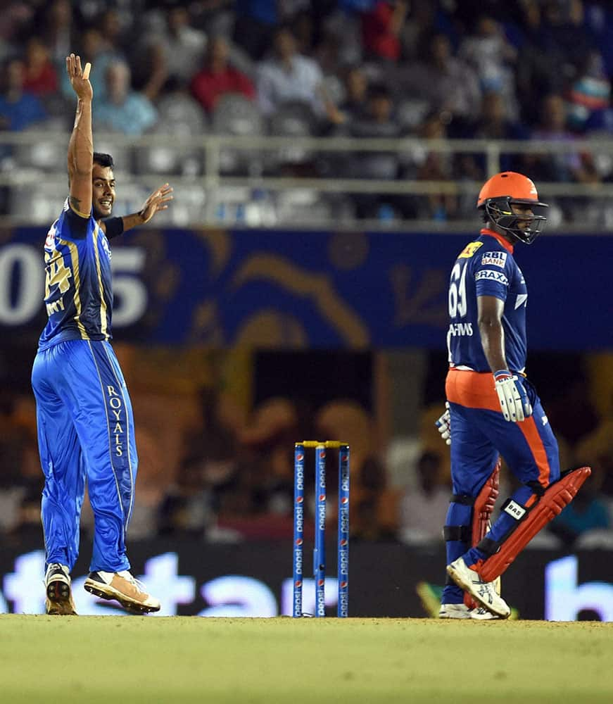 Rajasthan Royals player Stuart Binny celebrates the wicket of Angelo Mahews during an IPL match in Mumbai.