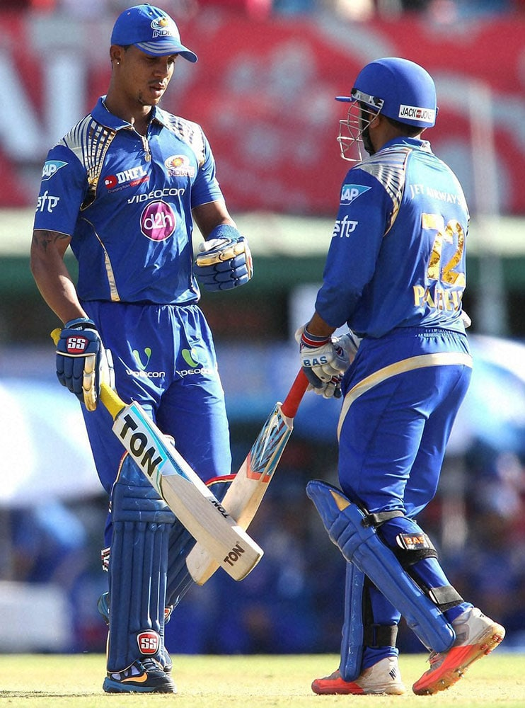 Lendl Simmons of Mumbai Indians congratulates Parthiv Patel of Mumbai Indians for reaching his fifty during IPL match against Kings XI Punjab in Mohali.