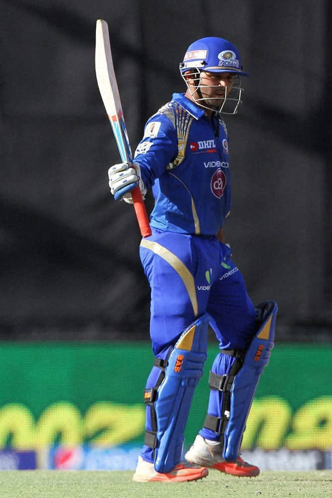 Parthiv Patel of the Mumbai Indians raises his bat after scoring 50 runs during IPL match against The Mumbai Indians in Mohali.