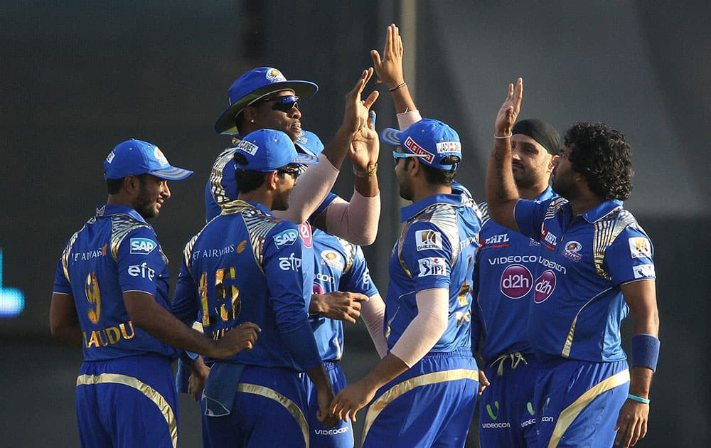 Kieron Pollard of Mumbai Indians and Lasith Malinga of Mumbai Indians are congratulated for getting Virender Sehwag of Kings XI Punjab wicket during IPL match in Mohali.