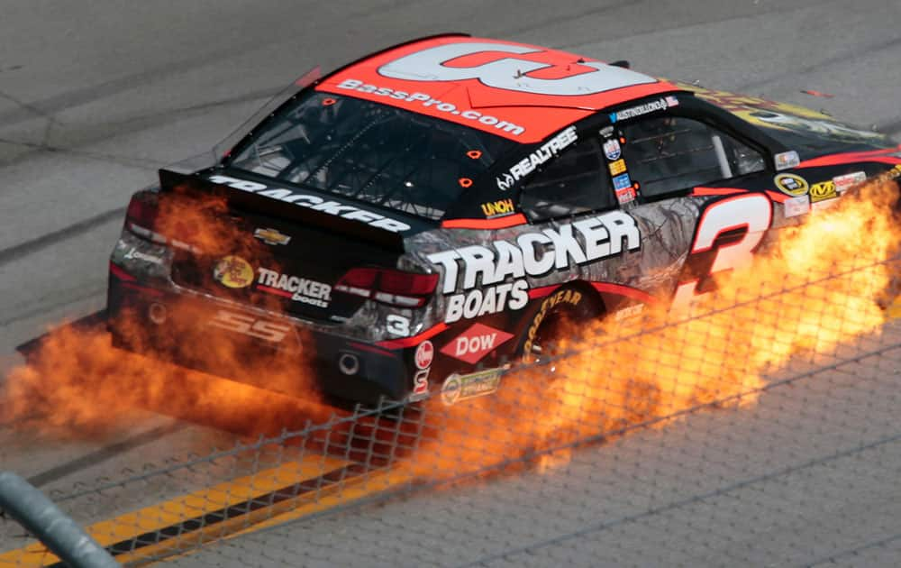 Austin Dillon's car catches fire during the Talladega 500 NASCAR Sprint Cup Series auto race at Talladega Superspeedway, in Talladega, Ala.