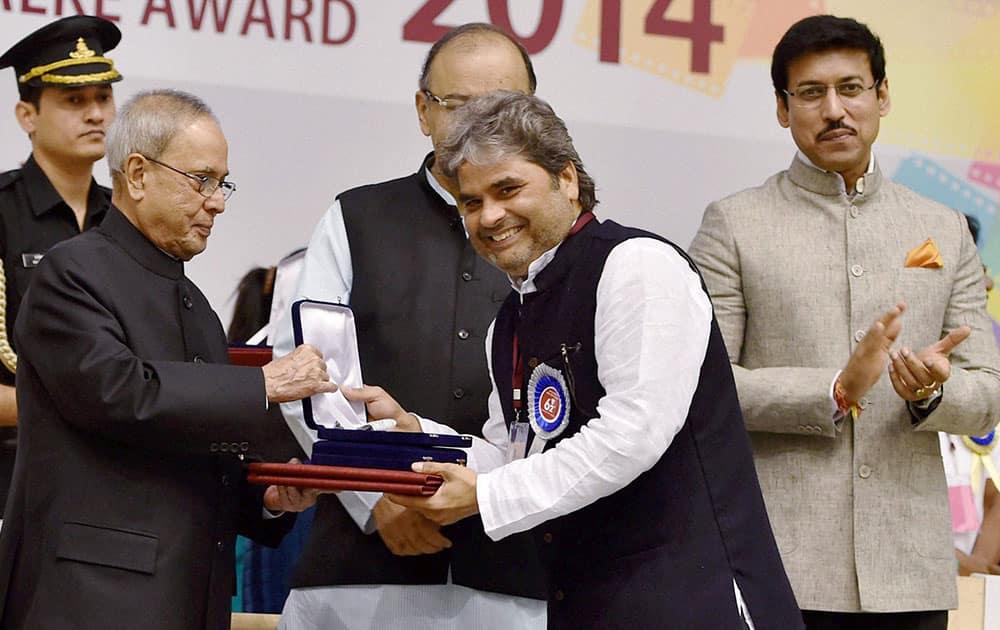 President Pranab Mukherjee presenting 62nd National Film Award for Best music direction for film Haider to Vishal Bhardwaj at the award ceremony in New Delhi.