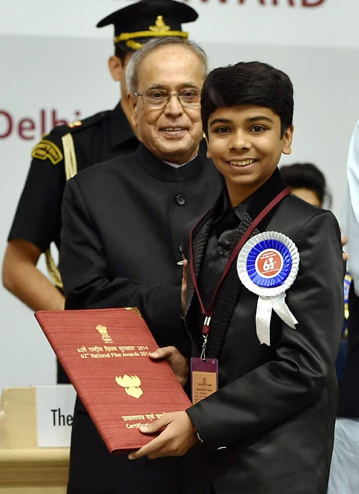 President Pranab Mukherjee presenting 62nd National Film Award to Special mention award to Parth Bhalerao at the award ceremony in New Delhi.