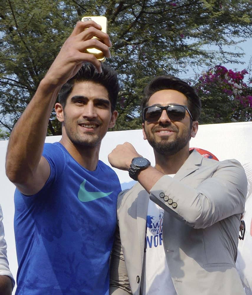 Bollywood actor Ayushman Khurana and boxer Vijender Singh pose during Wings for life world run in Gurgaon.