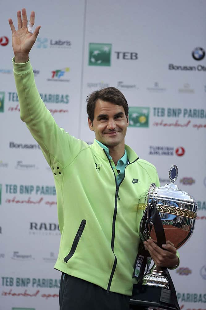 Roger Federer of Switzerland celebrates with his trophy after beating Pablo Cuevas of Uruguay following the final match of the Istanbul Open tennis tournament at Garanti Koza Arena in Istanbul, Turkey.