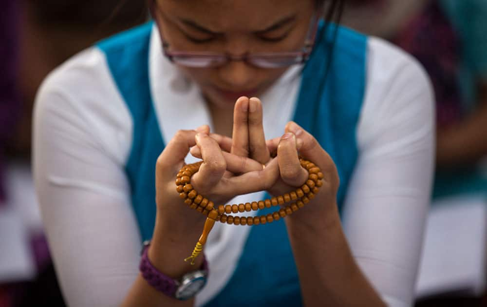 A Tibetan woman prays on the occasion of the Buddha Jayanti festival in New Delhi.