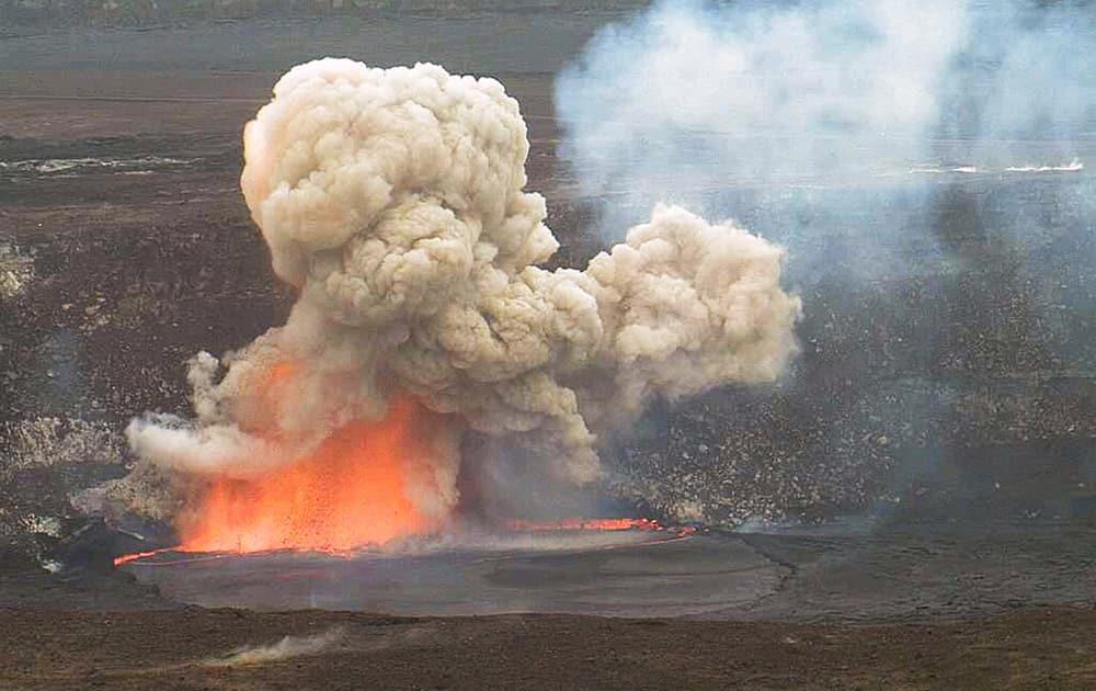 This photo provided by US Geological Survey Hawaiian Volcano Observatory, smoke and lava explode from Kilauea volcano on Hawaii's Big Island.