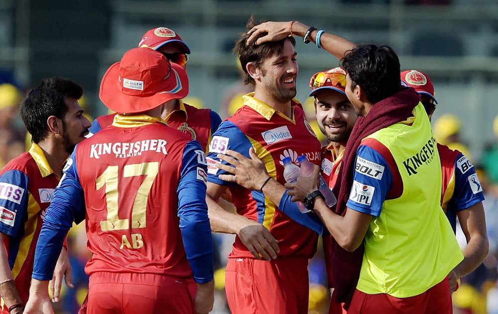 Royal Challengers Bangalore's David Wiese celebrating along with teammates the wicket of Chennai Super Kings Brendon McCullum during their IPL match at MAC Stadium in Chennai.
