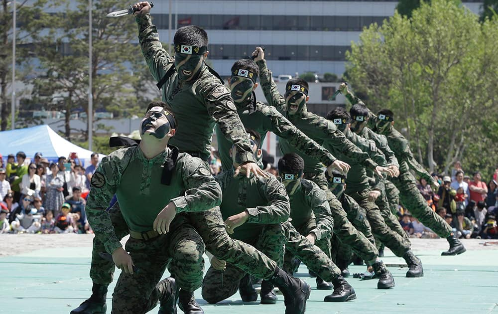 Soldiers from the South Korean army special forces demonstrate their skills how to fight back knife-wielding attackers during a martial arts demonstration for Children's Day at the War Museum in Seoul. May 5 is celebrated as Children's Day, a national holiday, in South Korea.