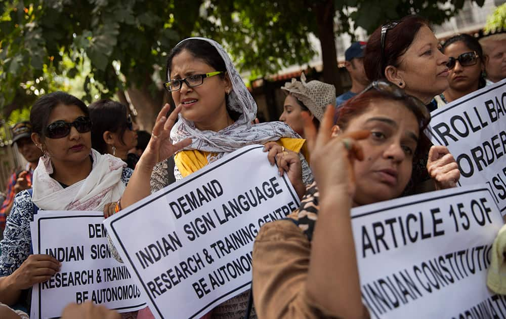 Deaf and hearing impaired women gesture during a protest in New Delhi. The protest against the government's decision to demand that the Indian Sign Language Research and Training Centre (ISLRTC) be autonomous and managed by the National Association of Deaf (DAF)
