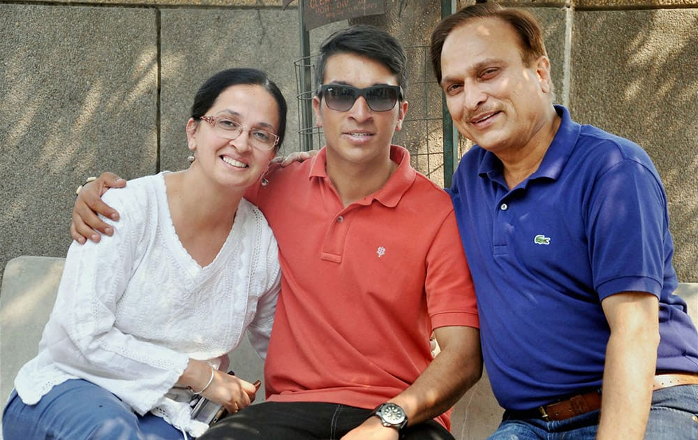 Mountaineer Arjun Vajpayee with his parents at his home in Noida on Tuesday after being rescued from earthquake hit Nepal.