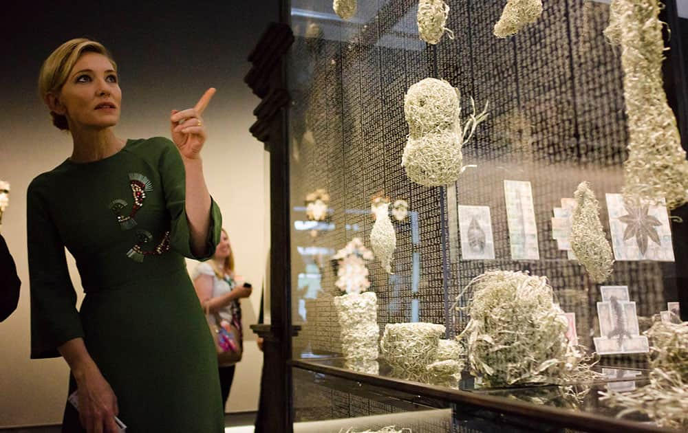 Actress Cate Blanchett looks at artworks on display during the inauguration of the Australian pavilion at the 56th Biennale of Arts in Venice.